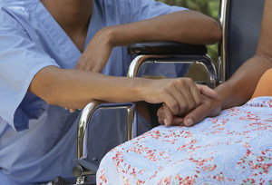 Close up of nurse holding patientís hand